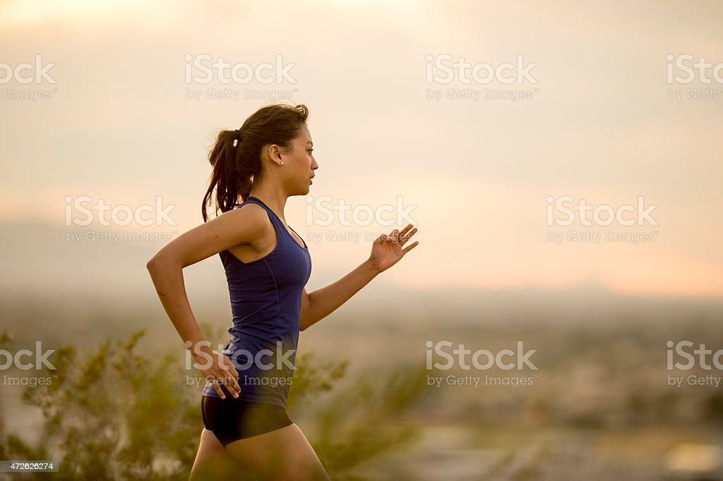 Trail Run at Dusk stock photo