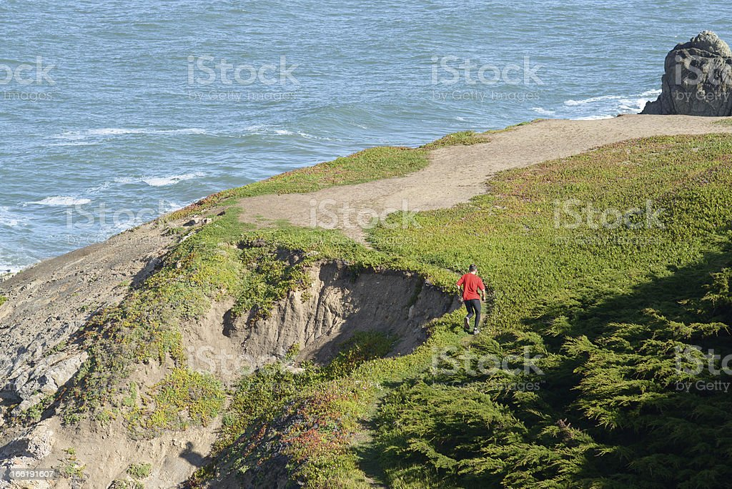 Trail Runner Along the Coast stock photo