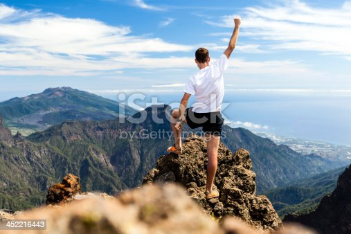 Trail runner, man and success in mountains. Running, sports, fitness and healthy lifestyle outdoors in summer nature