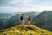 istock Trail runners ascend high mountain ridge 1257851030