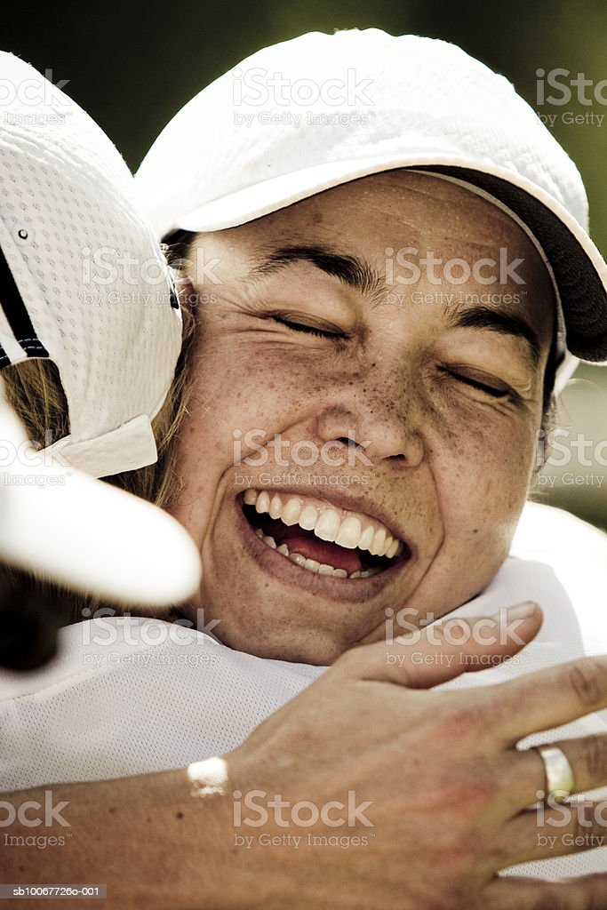 Trail runners embracing outdoors, laughing royalty-free stock photo