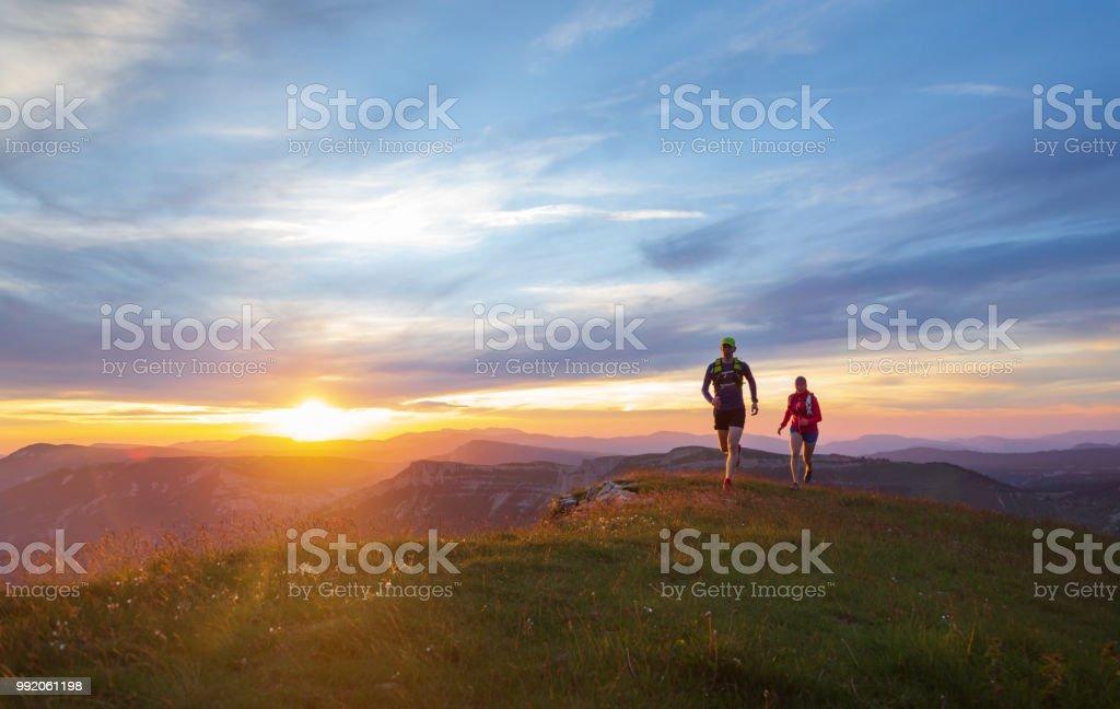 Trail running at sunset stock photo
