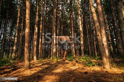 485902386istockphoto Trail running big jump 1154836633