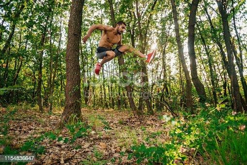485902386istockphoto Trail running big jump 1154836647