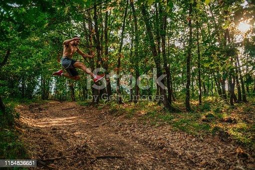 485902386istockphoto Trail running big jump 1154836651