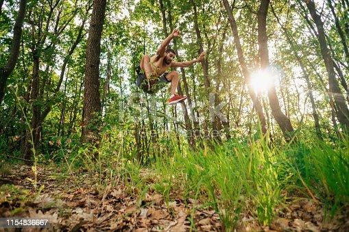 485902386istockphoto Trail running big jump 1154836667