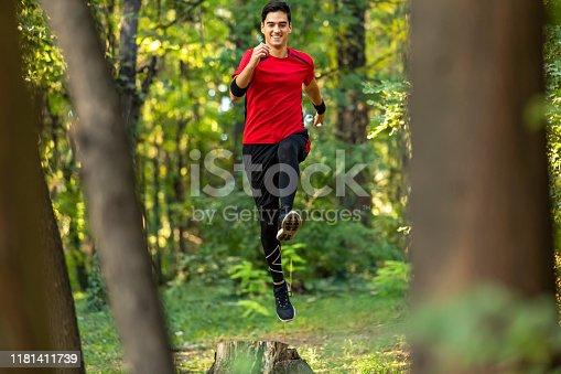485902386istockphoto Trail running big jump 1181411739