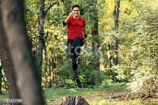 485902386istockphoto Trail running big jump 1181411790