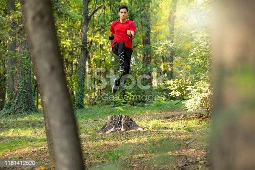 485902386istockphoto Trail running big jump 1181412520