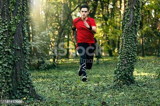 485902386istockphoto Trail running big jump 1181412666