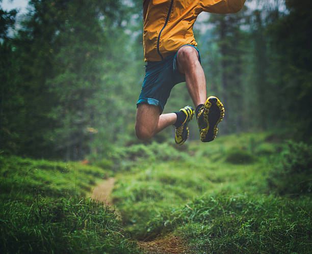 trail running big jump - vitality stock photos and pictures
