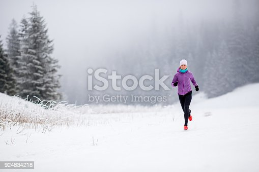 484750230 istock photo Trail running girl in winter mountains 924834218