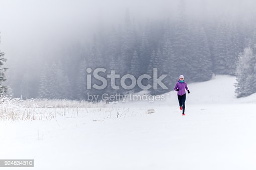 484750230 istock photo Trail running girl in winter mountains 924834310