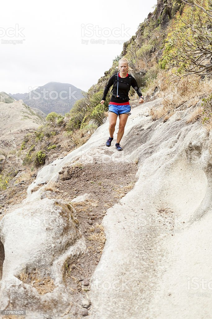 Trail running in mountains royalty-free stock photo