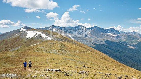 Ten Mile Range, Colorado, USA - August 28, 2011: Two trail runners on the Colorado Trail in the Rocky Mountains.