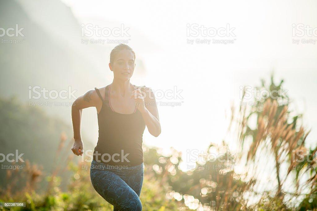 Trail Running on a Hawaiian Mountain stock photo