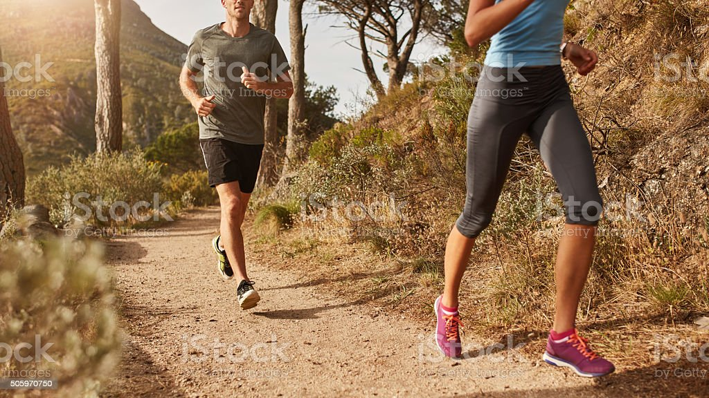 Trail running on a mountain path stock photo