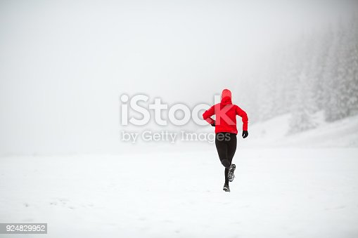 484750230 istock photo Trail running woman in winter mountains 924829952