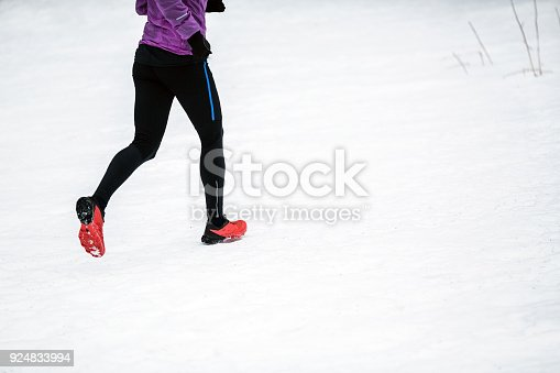 484750230 istock photo Trail running woman in winter mountains 924833994