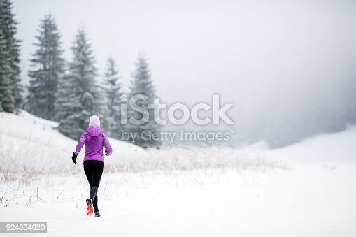 484750230 istock photo Trail running woman in winter mountains 924834020