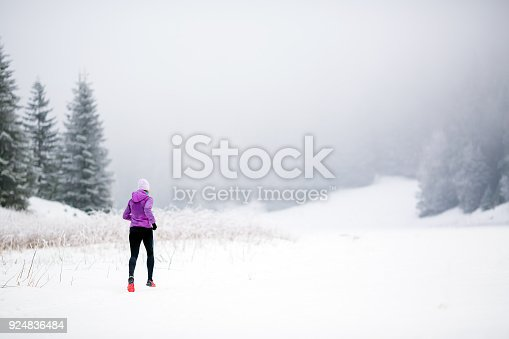 484750230 istock photo Trail running woman in winter mountains 924836484