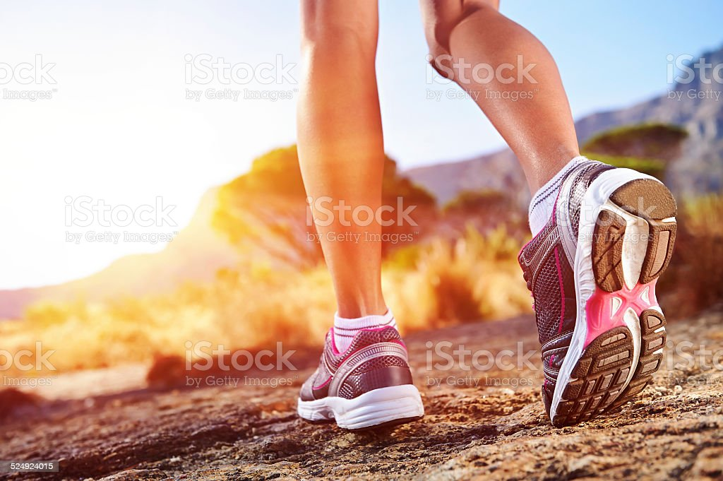 trail running woman stock photo