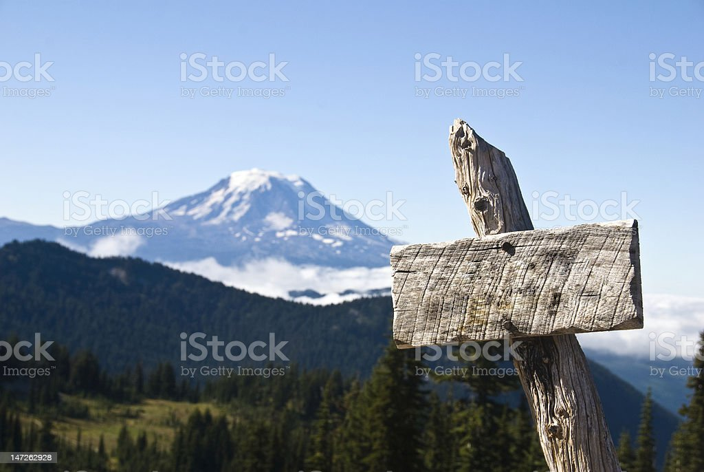 Trail sign and mountain stock photo