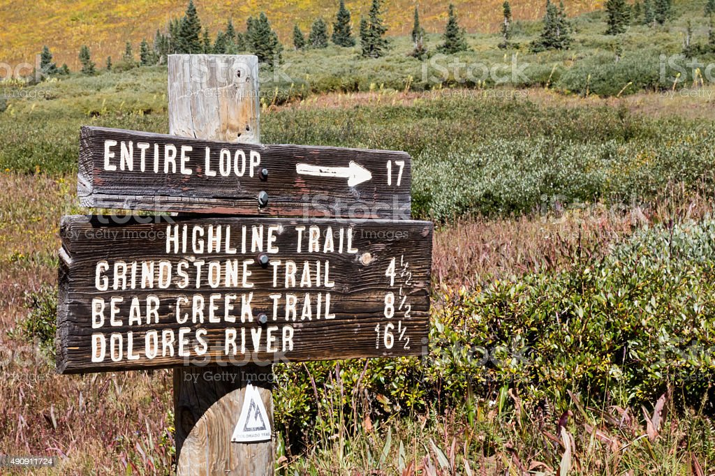 Trail sign of the CO trail with distances stock photo