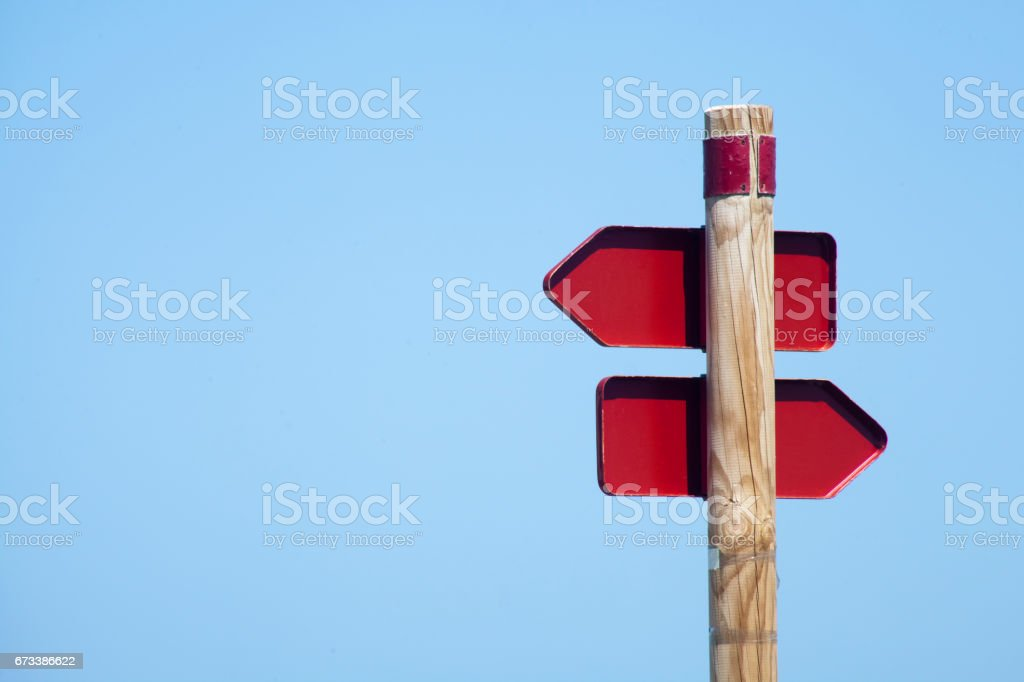 Trail sign post with clear blue sky background. stock photo