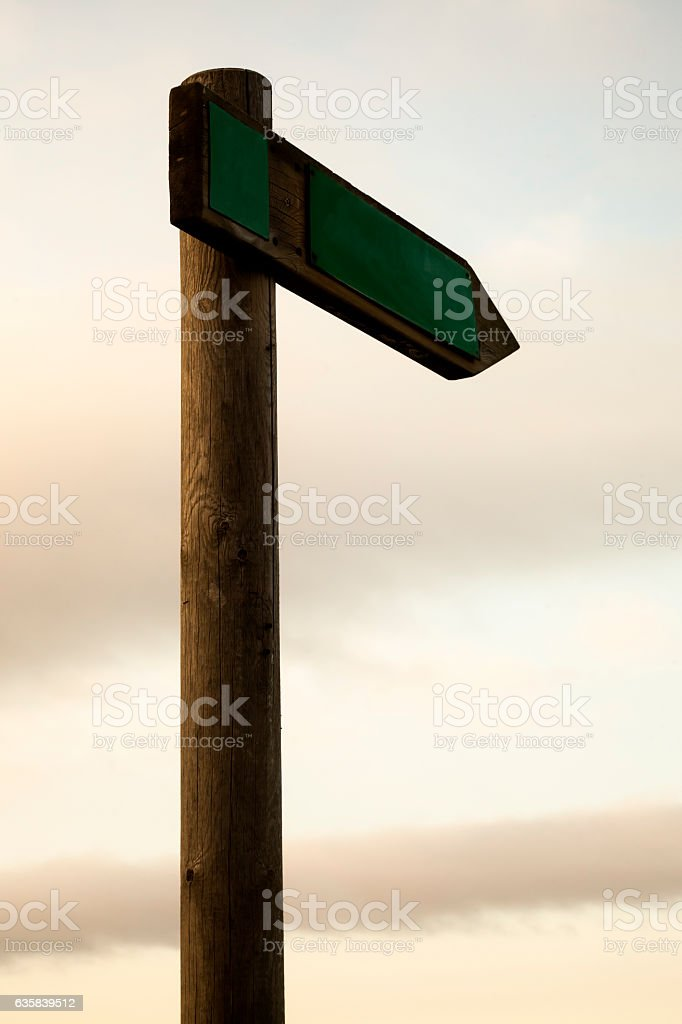 Trail sign post with dusk sky background. stock photo