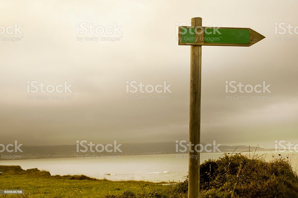 Trail sign post with seascape background. stock photo