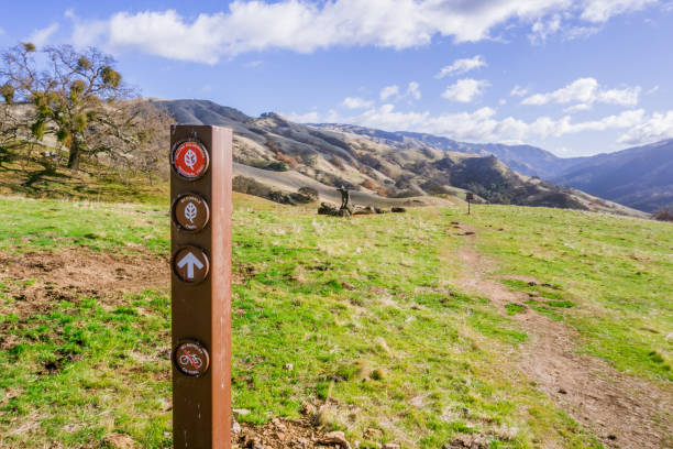 Trail sign posted in Sunol Regional Wilderness, San Francisco bay area, California Trail sign posted in Sunol Regional Wilderness, San Francisco bay area, California alameda california stock pictures, royalty-free photos & images