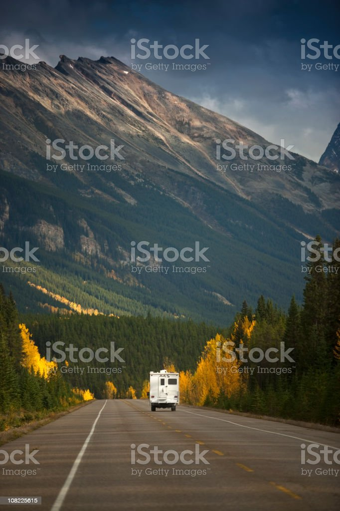 Trailer Driving Through Mountains royalty-free stock photo