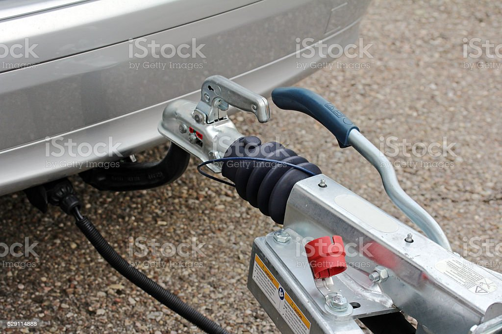 Trailer hitch with trailer on a car stock photo
