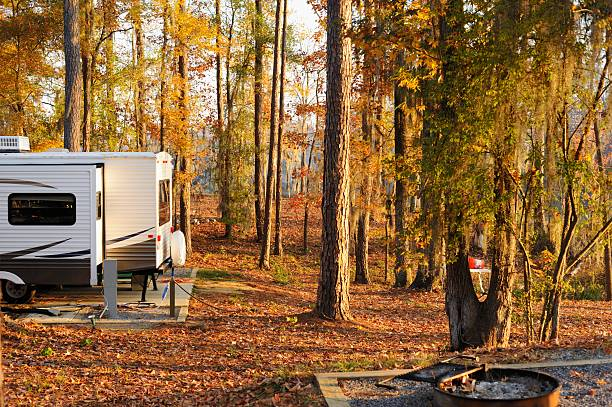 RV trailer in campground during morning or evening stock photo
