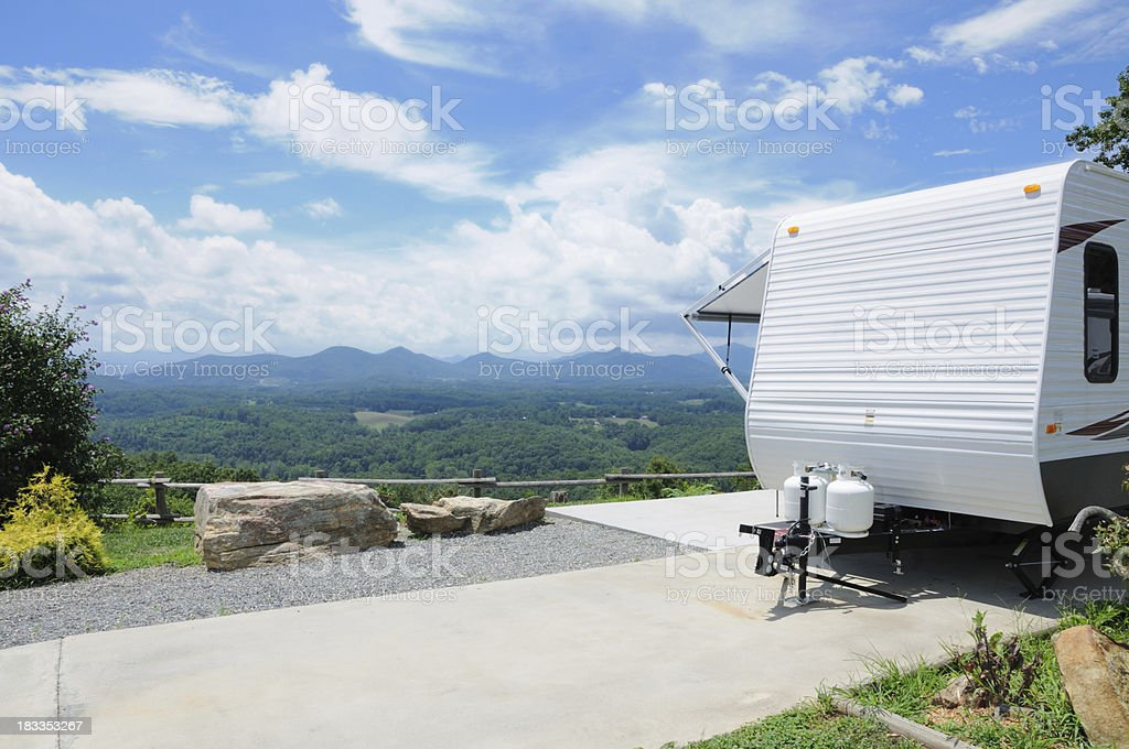 RV trailer in scenic mountain top campground royalty-free stock photo