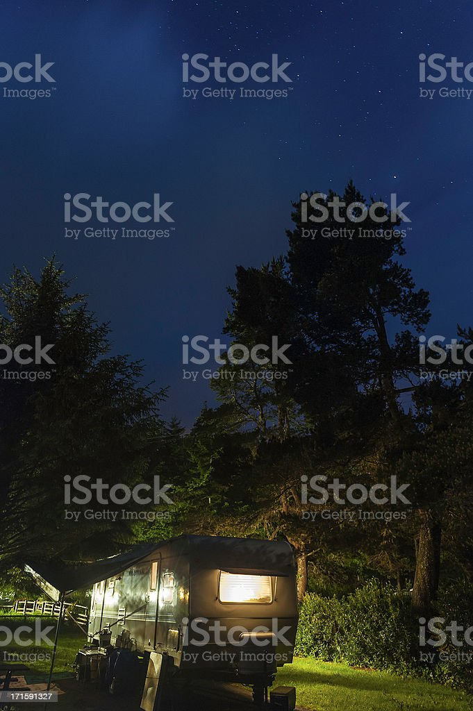 Trailer in State Park illuminated under starry sky royalty-free stock photo
