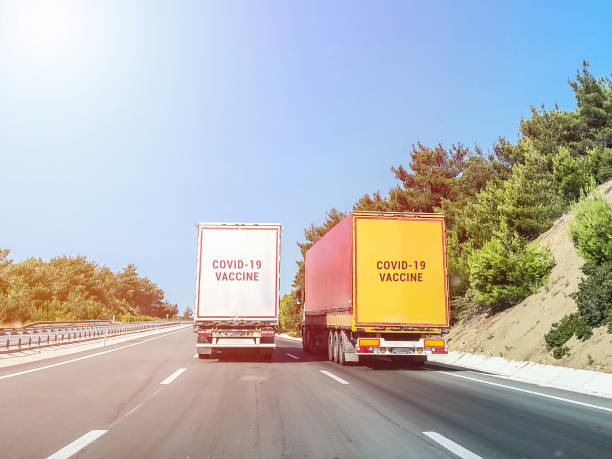 Trailer truck delivering covid-19 vaccine stock photo