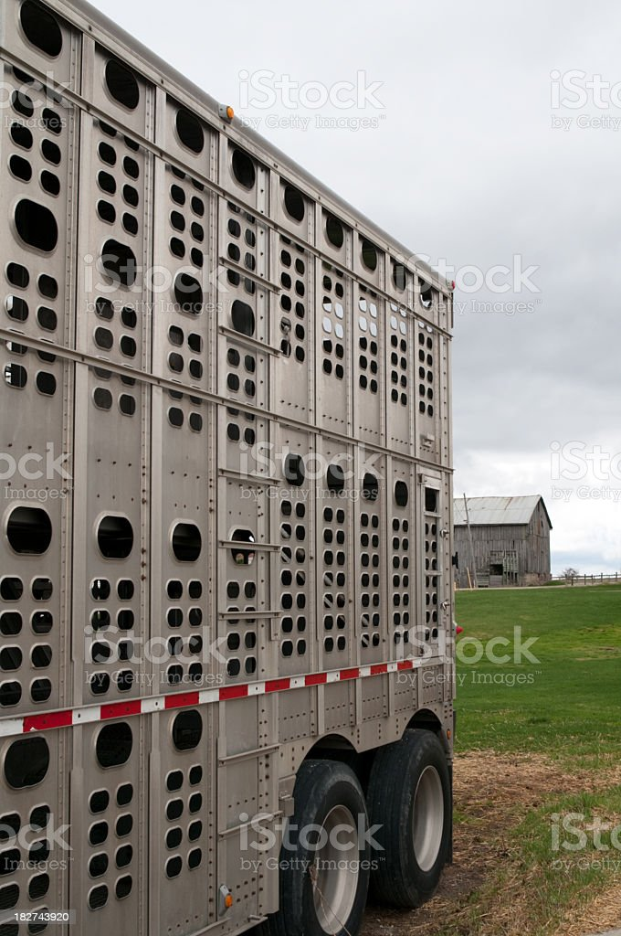 Trailer with barn and green grass royalty-free stock photo