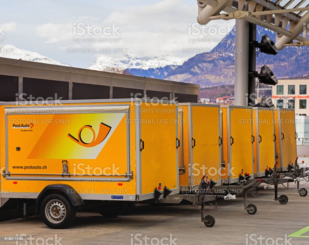 Trailers for Post Buses at the bus station in the city of Chur in Switzerland stock photo