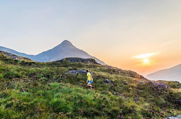 trailrunner in the scottish highlands at loch leven, great brittain - see loch leven stock-fotos und bilder