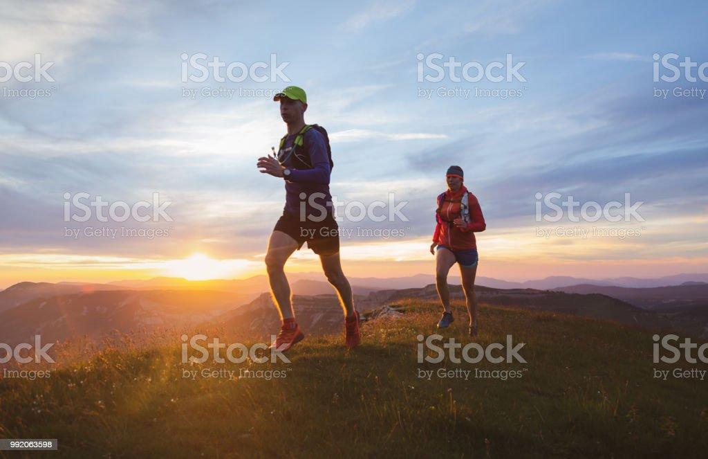Trailrunning couple stock photo