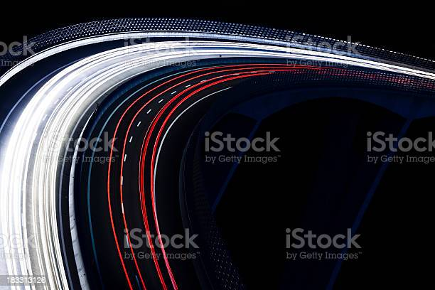Photo of Trails for a traffic light on a black background