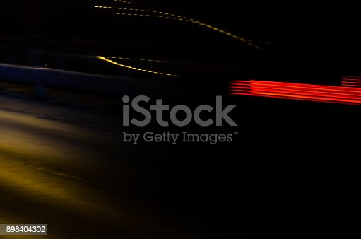 1023119734 istock photo Trails of the car lights 898404302