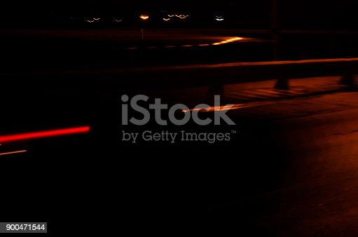 1023119734 istock photo Trails of the car lights 900471544