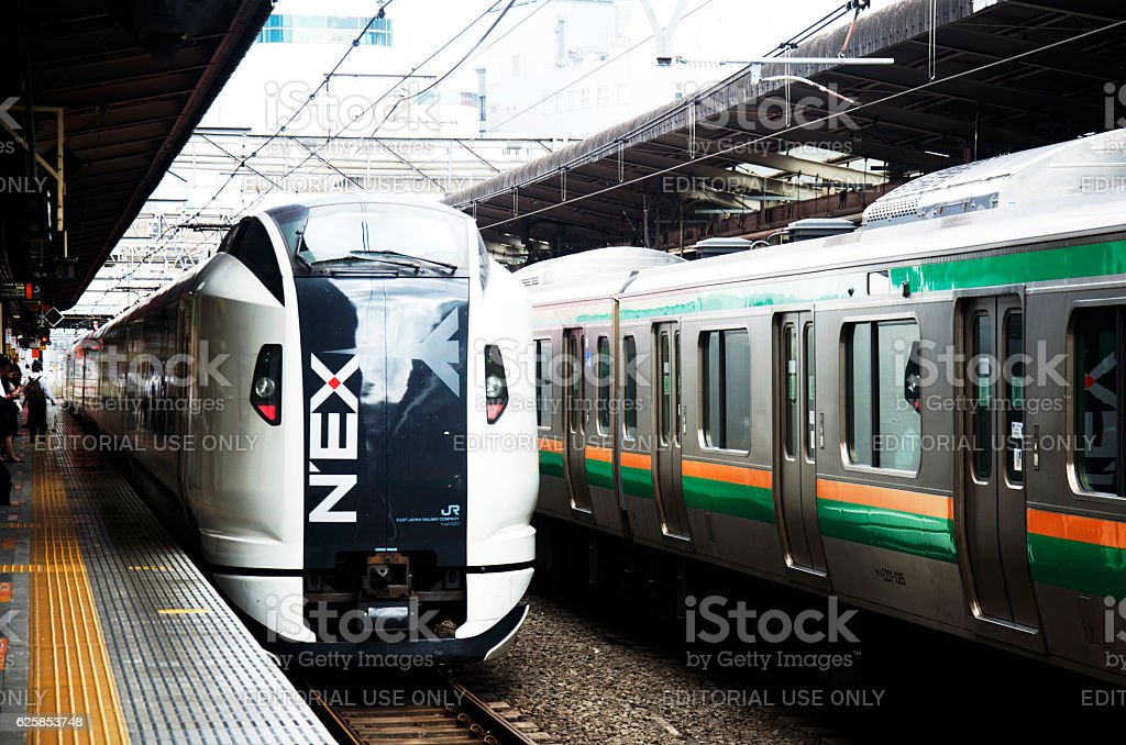 NEX train and railway stop sending and receive passengers people stock photo