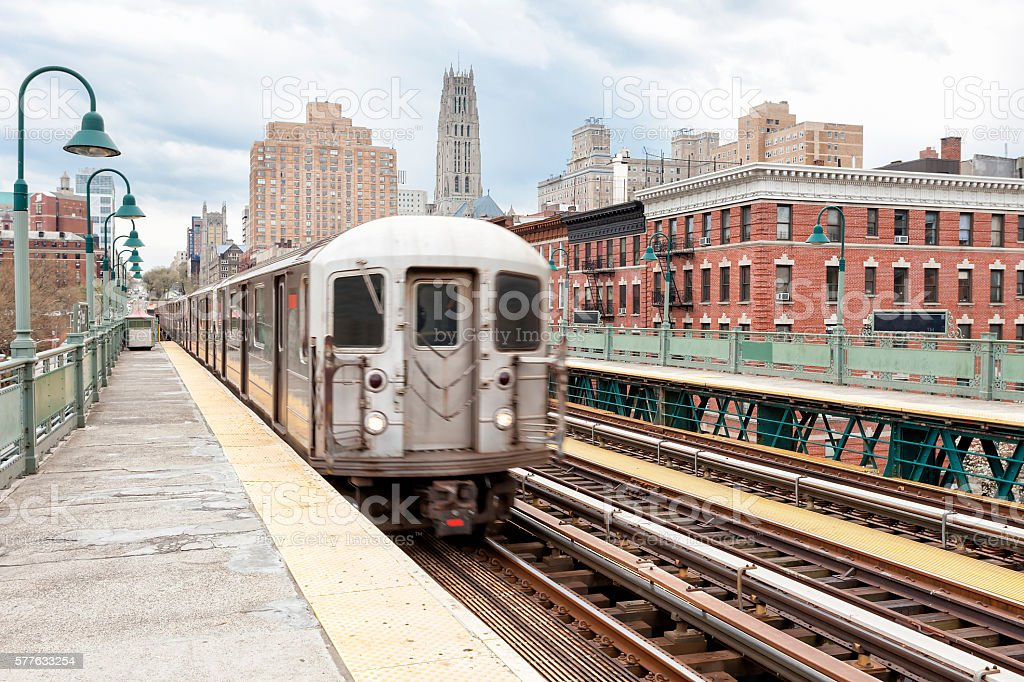 Train Approaching  Elevated Subway Station in Harlem, New York stock photo