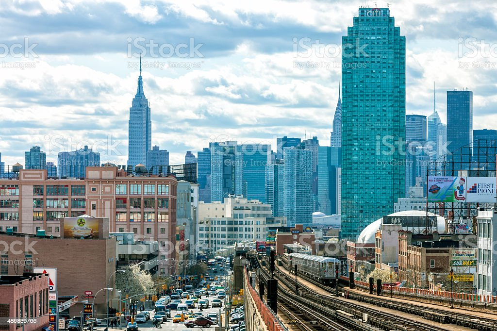 Train Approaching Elevated Subway Station in Queens, New York stock photo