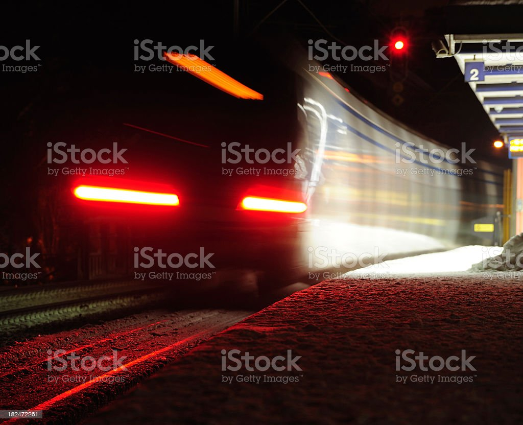 Train approaching semi-outdoor railway station royalty-free stock photo