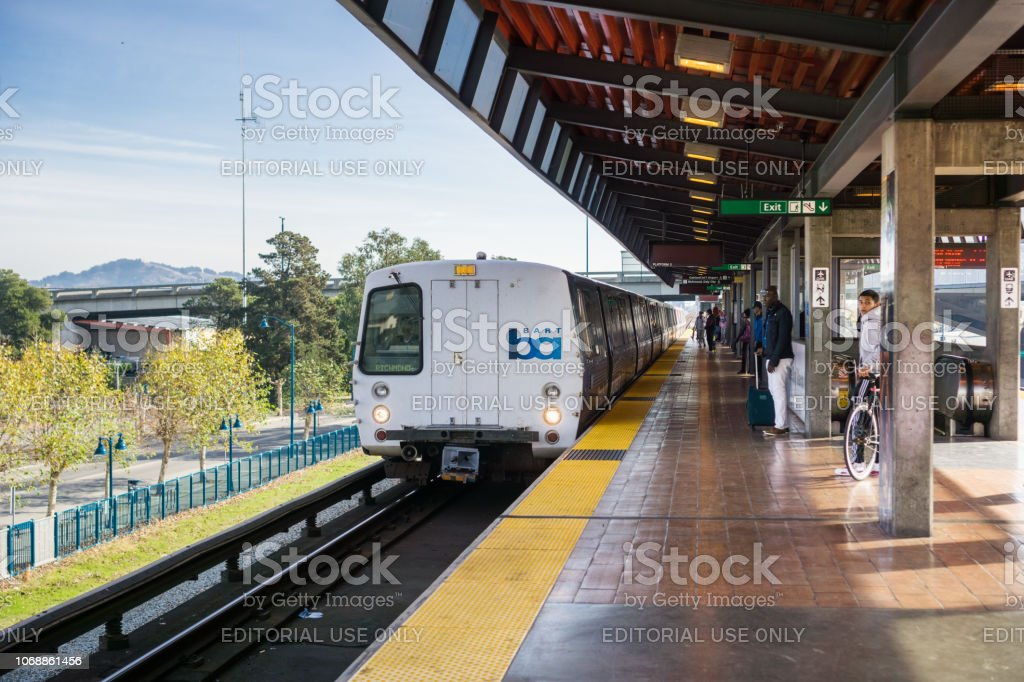 BART train arriving at a station stock photo